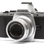 Got my camera back from the Olympus service center.