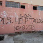 Spray painted sign on the wall of a building in Tacloban City