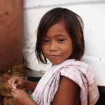 This young girl was hanging out with her friends inside a truck destroyed by the typhoon